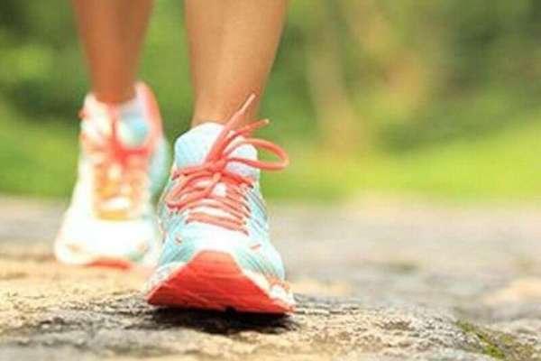 feet walking in sneakers