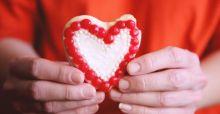 heart cookie in hands